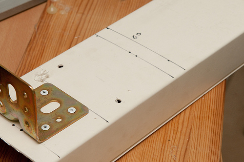 holes drilled for bungee cord (by udijw)