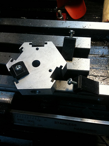 Inserts, cut, shaped. Holes, drilled and tapped.