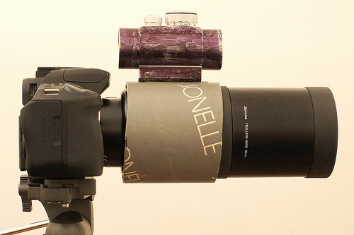 500mm reflex with long lens hood and red dot sight