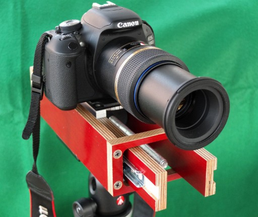 Side view, camera and macro lens attached, moving section protruding through forward end plate.