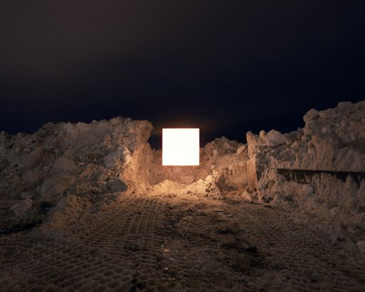 Photos Of A Giant Square Floating In Various Locations