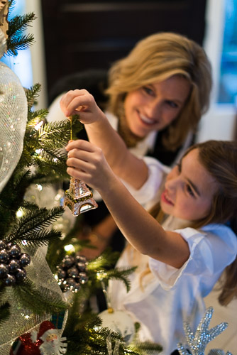 christmas stock photo christmas stock photography mother and daughter decorating christmas tree