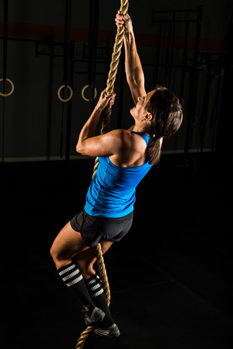 female crossfit athlete climbing rope at gym jp danko toronto commercial photographer