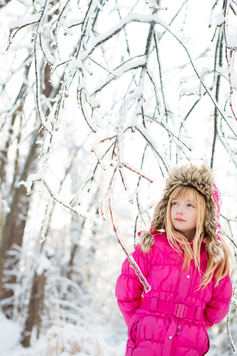 Little girl outdoors in ice and snow in winter in fur hat lifestyle portrait jp danko toronto commercial photographer