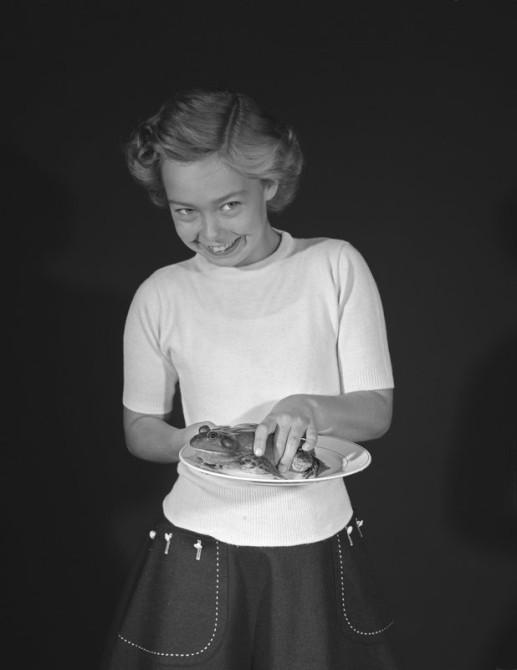 Girl holding bull frog, Natural Science Center, 1958. Credit: Robert Elwood Logan (125310)