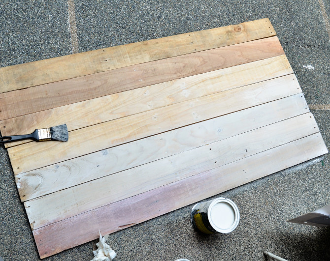 First coat of white paint on the plank side