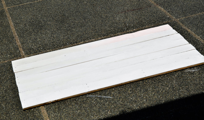 After painting the wood plank side plain white and letting it dry in the sun