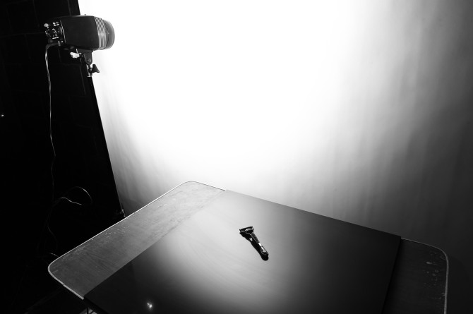 Setup Shot. I pointed my studio strobe at the white seamless paper and used the reflection of the granite tile to get the gradient effect of the light on the background.