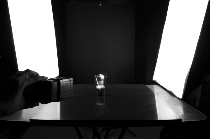 I used a black illustration board for my black background. Two softboxes were placed left and right of the subject for rim lighting and for the mainlight I handheld a speedlight with a diy honeycomb