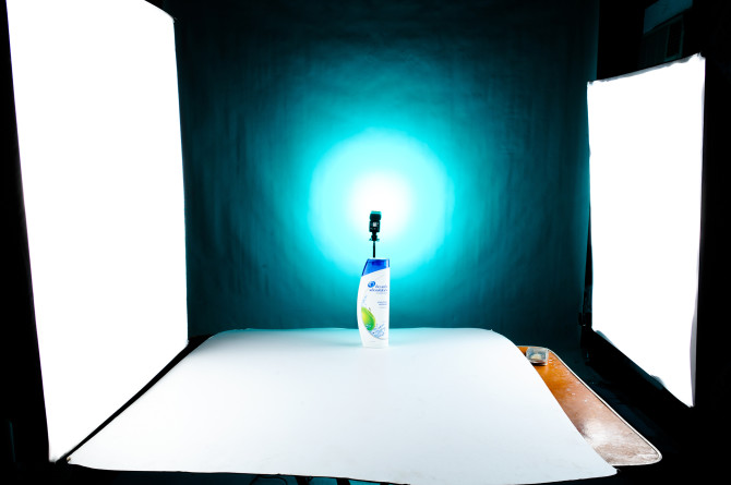 Final Setup for this Set. Cyan gel on the background with stofen omnibounce and two softboxes left and right fot the mainlight and highlight. I also used illustration board as my base