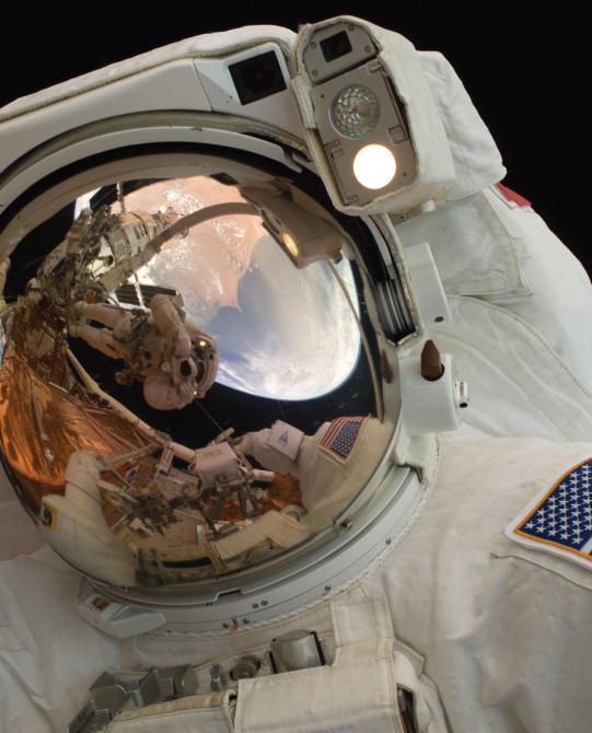 Spacewalking Astronaut John Grunsfeld; Photo Credit: NASA