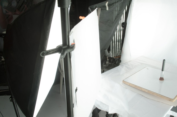 Scrim in between the subject and the softbox