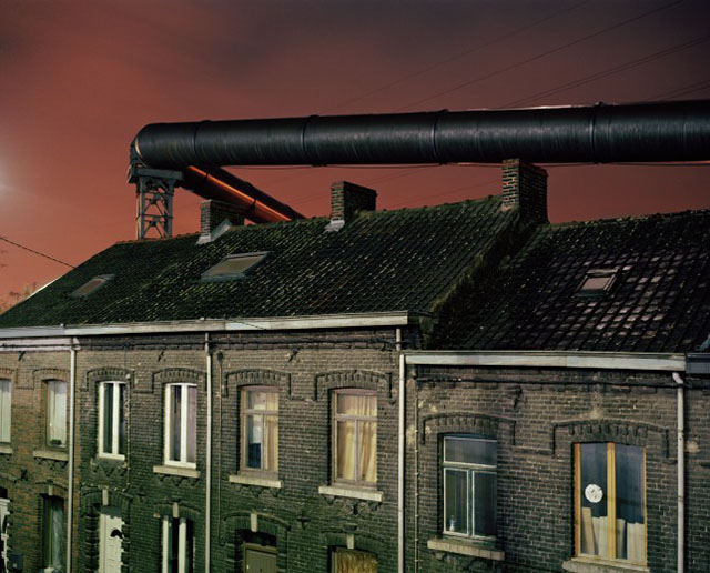 Gas supply tubes run along the houses built near the steel factories of Charleroi. Before the electric upgrade of the blast furnace, these tubes used to provide the energy needed for this operation.  (Photo by Giovanni Troilo)