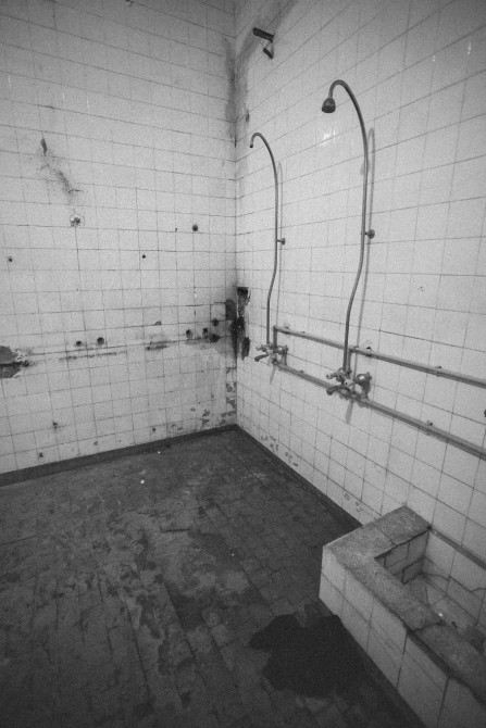 The shower room, showing the disrepair on the facility.