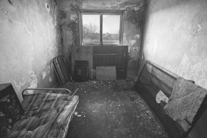 A hotel room inside the Rowing Base of Vidin, Bulgaria showing grotesque signs of decay and disrepair.