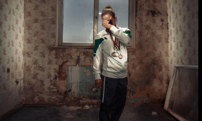Gold medalist Tsvetelina Tsvetanova seen standing in a hotel room at her training facility in Vidin, Bulgaria.