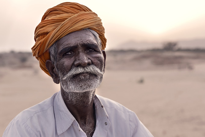 """""""In your eyes I see the sunlight but I also see the darkness"""". While this man in the desert of India just enjoyed from his heart to play music for us, a moment later I saw this look on his eyes and had to capture it. His eyes tell a story and everyone is free to interpret it his own way."""