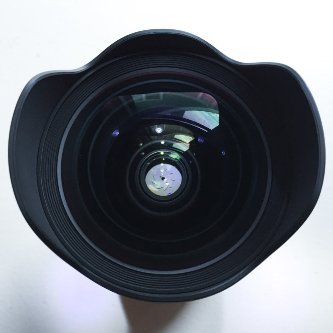 The front element of this lens doesn't take standard screw-on filters. Sigma uses their Super Multi-Layer Coating to prevent flares, and ghosting.
