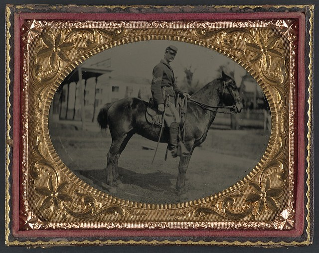 Ambrotype: Unidentified soldier in Union sergeant's uniform with sword seated on a horse. Made available by the Library of Congress via Flickr Commons