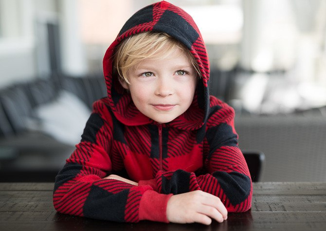 Portrait of blonde little boy (7) with messy hair in the morning
