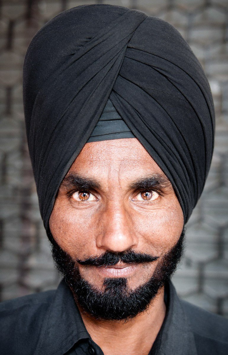 This man's face and eyes were so compelling that I didn't need to include anything else in the image to make it have an impact. (Chandigarh, India. 2011.)
