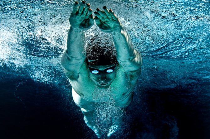 Competitive swimmer in breast stroke glide from underwater