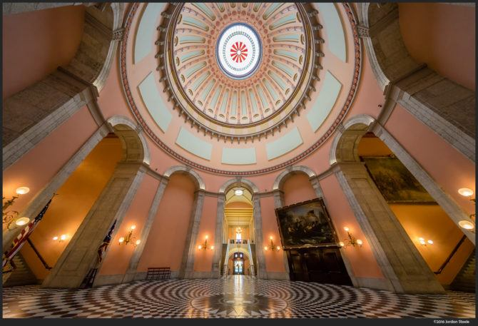You can incorporate the perspective distortion into the composition, as I did in this shot. Ohio Statehouse Rotunda – Sony A7 II with Voigtländer 10mm f/5.6 @ f/8