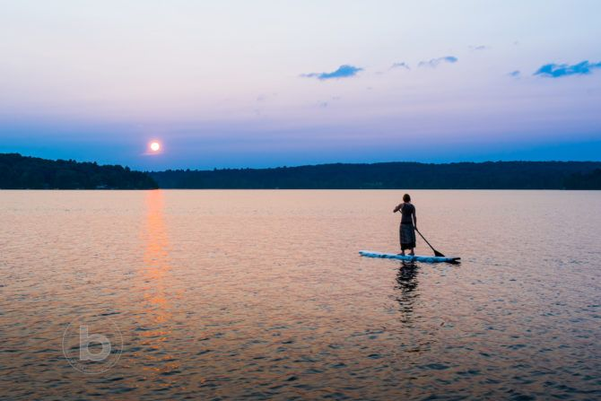 Summer Inspiration Woman on a stand up paddle board
