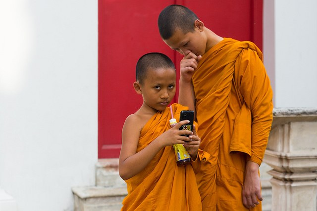 The strong verticals together with the inward leaning stances of the young monks makes this a self-contained, closed image.