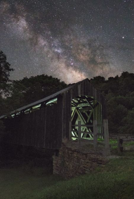 This is 4 exposures. One star tracked for the sky at ISO 800, f/2.8, 110 secs. The outside of the bridge was lit by star light alone for a 5 minute exposure at ISO 1600, f/2.8. The inside of the bridge was lit using the LED panel on a tripod at ISO 1600, f/2.8, 15 seconds. Two exposures were required to cover the front and back.