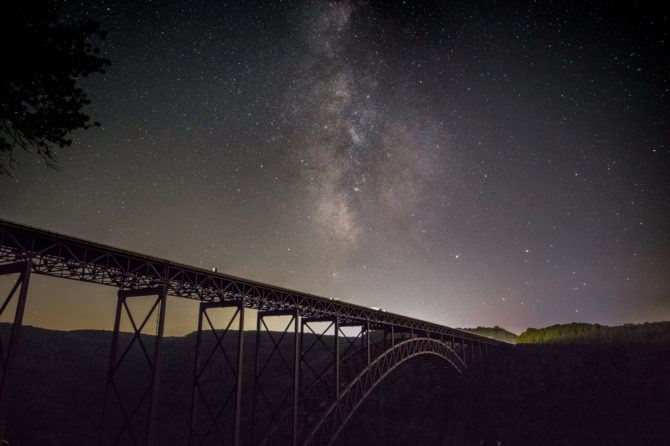Here, the New River Gorge Bridge was shot at moon set early in the evening. I waited 2 hours later to shoot the Milky Way when it reached the center point of the bridge as it moved through the sky. ISO 3200, f/2.8, 15 secs.