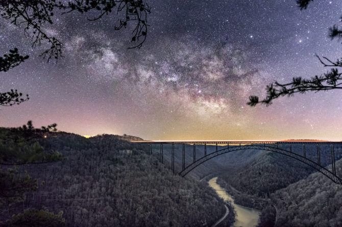 Another angle on the New River Gorge Bridge. This time I used morning twilight to provide lighting of the landscape. The Milky Way was taken at 3 am, while the landscape was shot about 3 hours later, a bit before sunrise. Additionally, 12 foreground shots were stacked in order to reduce noise. The time when astronomical twilight begins, or just before it ends is the best time for these shots because the result is not overly bright and blends well with the night sky.