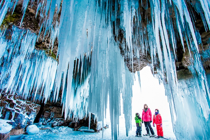 Family outdoors on snow shoes in winter exploring frozen Georgian Bay, Ontario