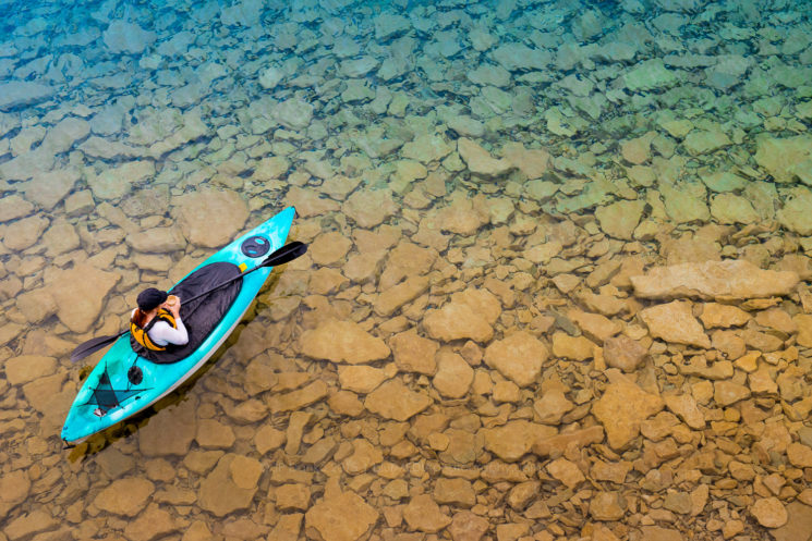 Woman in Kayak - Stock Photography JP Danko blurMEDIA