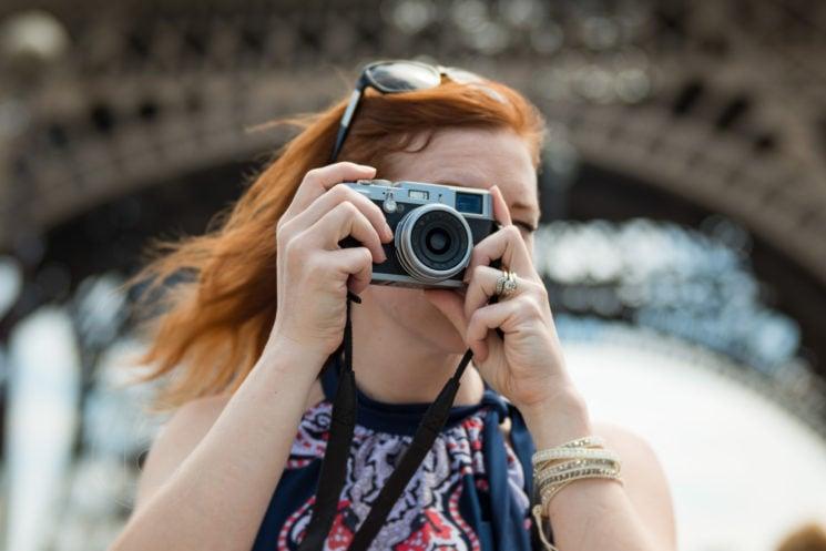 Woman with vintage camera in paris