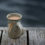 Coffee mug on a weathered cottage dock in early morning on summer day.